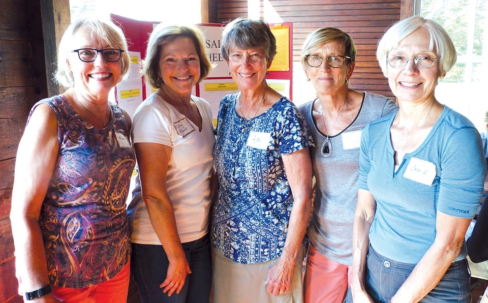 Prepping for the Mystic Garden Club's annual Greens Sale are Judy Salerno, advance sales chair ; Cathy Alsop, sale co-chair; Amy Bush, flower box committee person; Karen Wolfskehl, club president; and Cassie VanDine, sale co-chair. (Toni Leland photo)