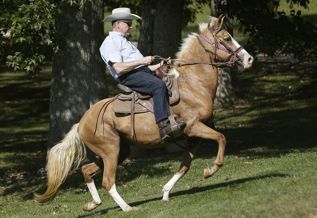 <b></b> In this Tuesday, Sept. 26, 2017 file photo, former Alabama Chief Justice and U.S. Senate candidate Roy Moore rides in on a horse to vote at the Gallant Volunteer Fire Department during the Alabama Senate race in Gallant, Ala. (AP Photo/Brynn Anderson, File)