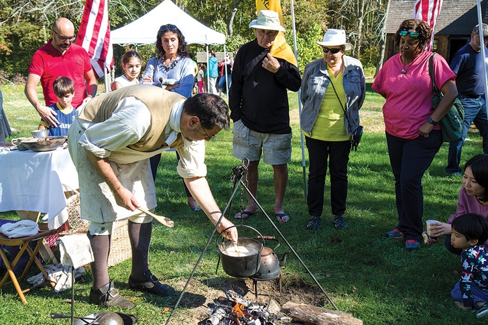 Robert Lecce, a member of the Friends, demonstrates Revolutionary War camp cooking of corn chowder and roasting chestnuts. (Renee Trafford photo)
