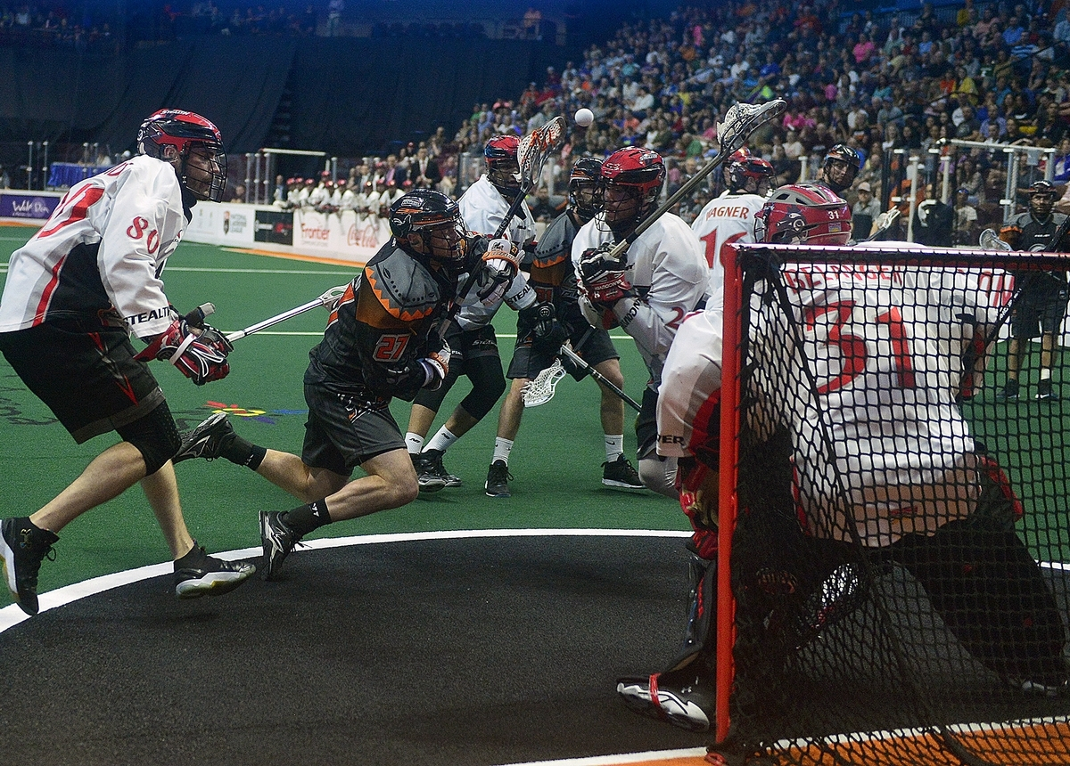 <b></b> New England Black Wolves' Kevin Buchanan (27) falls April 29, 2017, as he attempts a shot on goal during a game at Mohegan Sun Arena. (Sarah Gordon/The Day)