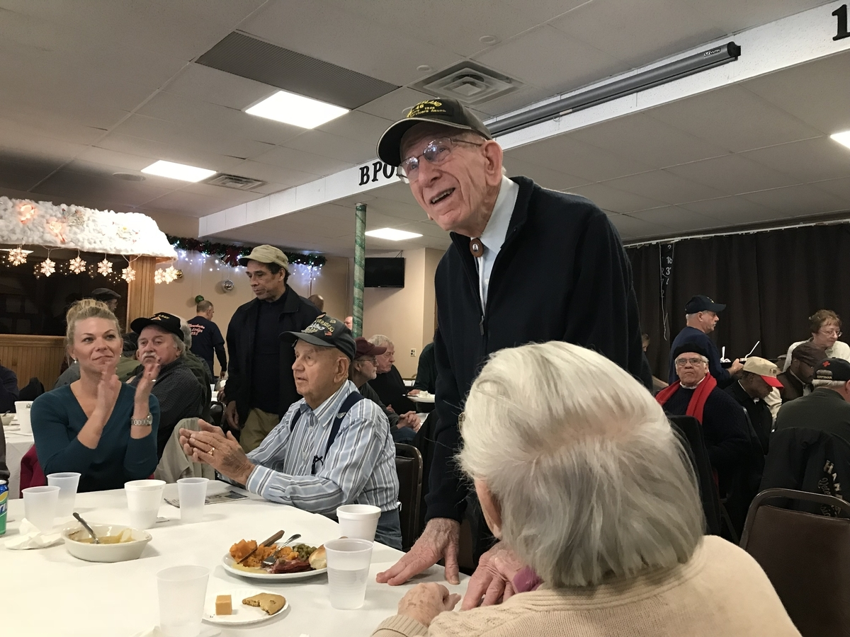 <b></b> Pearl Harbor survivor Floyd Welch, 96, of East Lyme stands to be recognized at an event marking the 76th anniversary of the attack on Pearl Harbor during World War II on Thursday, Dec. 7, 2017, at the Manchester Elks Lodge. (Julia Bergman/The Day)