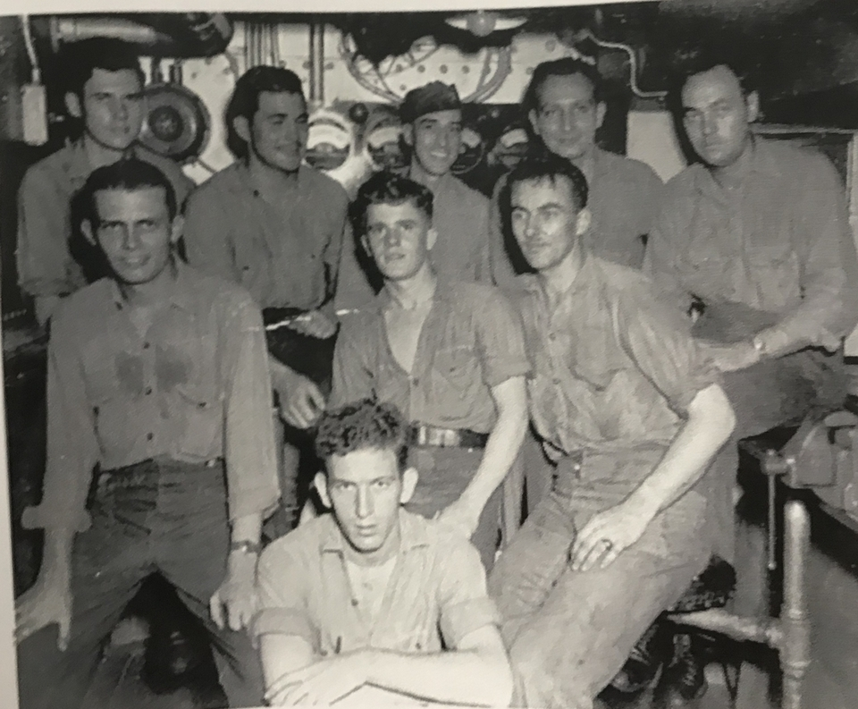 Pearl Harbor survivor Floyd Welch, 96, of East Lyme, center front, is seen with other crewmembers of the USS Maryland in the Interior Communications shop aboard the ship in this undated photo. (Courtesy of the Welch family)