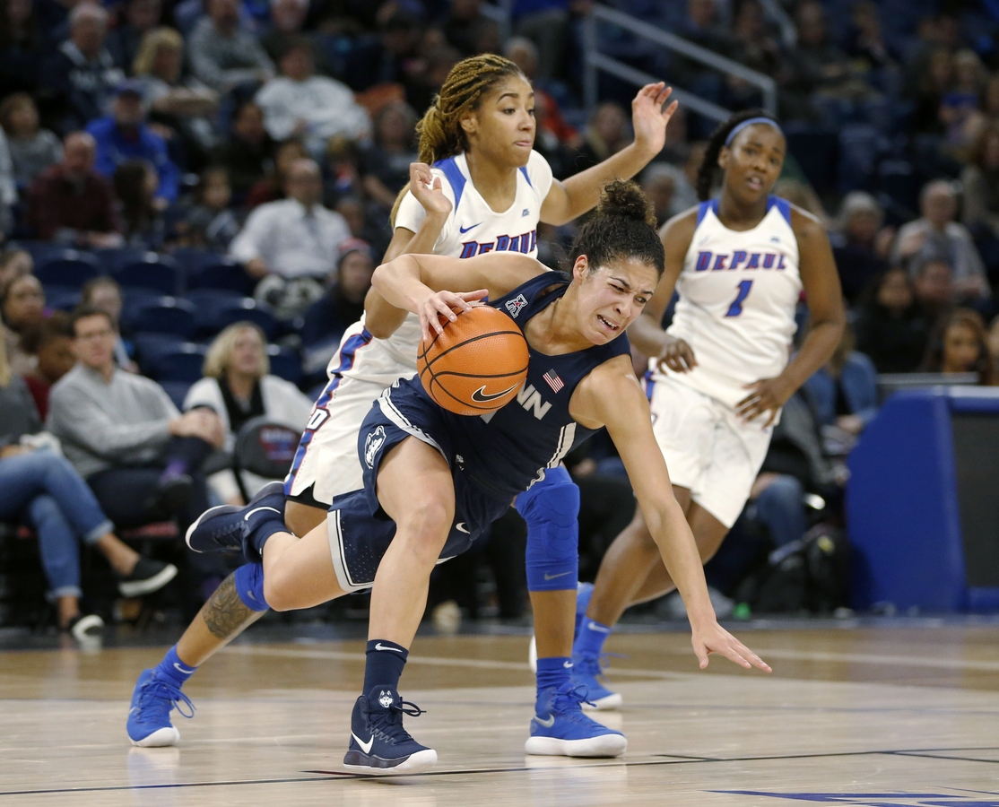 <b></b> UConn guard Kia Nurse is tripped by DePaul forward Mart'e Grays during the first half of the Huskies' 103-69 win on Friday night in Chicago. (AP Photo/Charles Rex Arbogast)