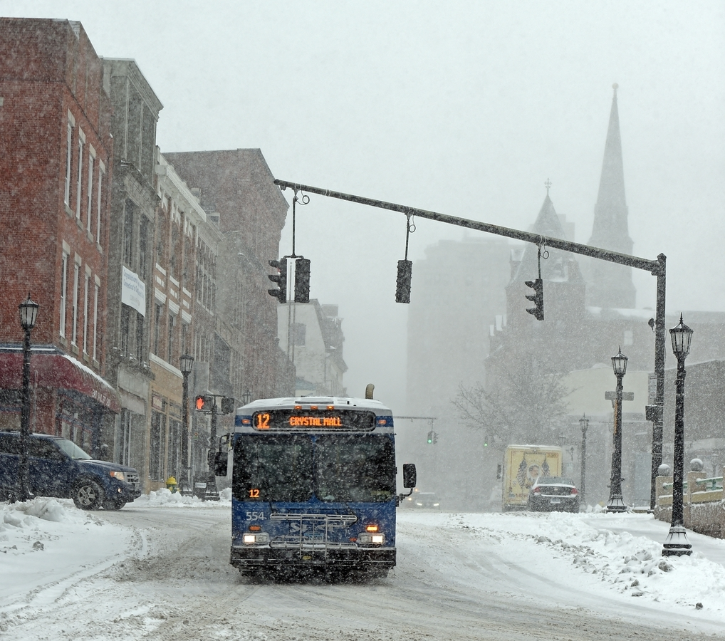 <b></b> A SEAT bus makes the turn from State Street onto Water Street in New London as a winter storm blankets the region in snow on Feb. 8, 2016. (Sean D. Elliot/The Day)