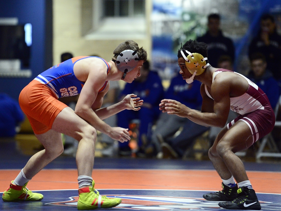 <b></b> Coast Guard Academy's Parker Brunkala, left, prepares to wrestles Rhode Island College's Brandon Nunez during the 125-pound match on Wednesday night at Billard Hall on the campus in New London. Brunkala won 15-5 and Coast Guard won the match 49-0.   (Sarah Gordon/The Day)