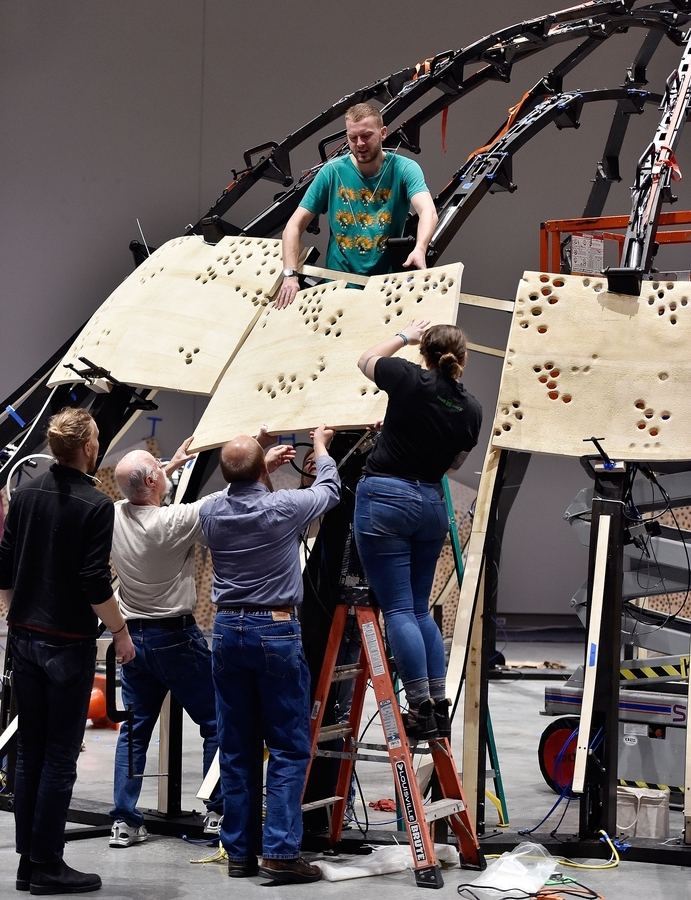 <b></b> A crew from John Grade Studio assemble a large immersive sculpture as part of the exhibit