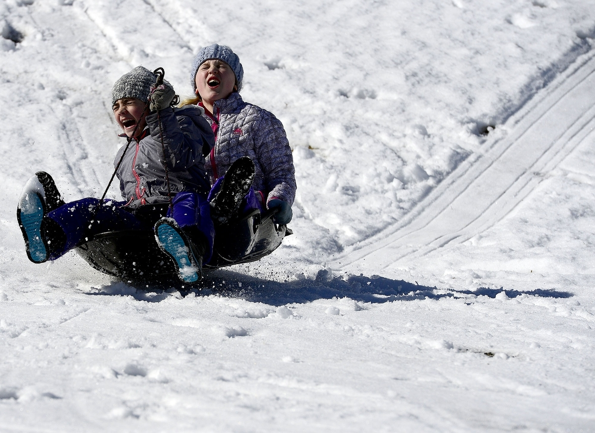 <b></b> Friends Gabriella Russ, left, 10, and Camryn Kelly, 9, both of Waterford, scream as they go over a bump on Sunday, February 18, 2018 at Washington Park in Groton. (Sarah Gordon/The Day)