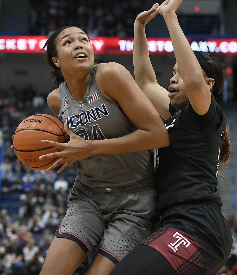 <b></b> UConn's Napheesa Collier, left, drives to the basket as Temple's Mia Davis defends during the first half of Sunday's game at the XL Center in Hartford. UConn won 106-45. (AP Photo/Jessica Hill)