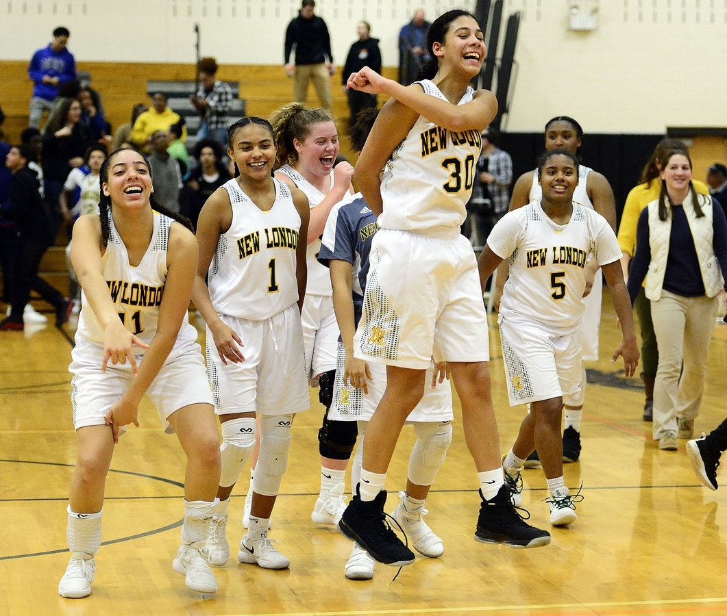 <b></b> New London's Taina Pagan (30) leads the celebration after the top-seeded Whalers defeated No. 2 NFA 57-28 at Plainfield High School to win their second straight Eastern Connecticut Conference Division I tournament title Wednesday night. (Sarah Gordon/The Day)