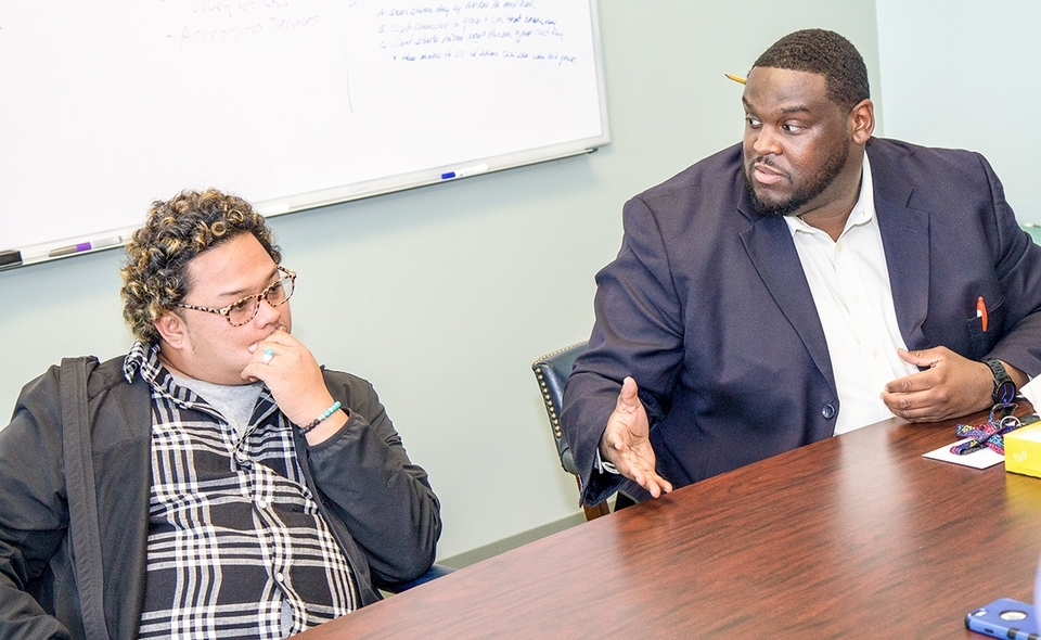 Erick, left, a client, and Errol Maurice, director of Residential and Young Adult Services, talk about meeting and surmounting challenges during a recent interview at Sound Community Services' New London headquarters. (Renee Trafford photo)