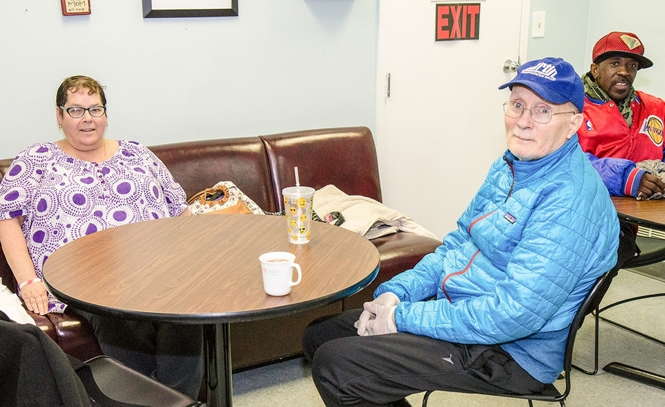 Friends catch up over coffee in the Oasis Center at Sound Community Services. (Renee Trafford photo)