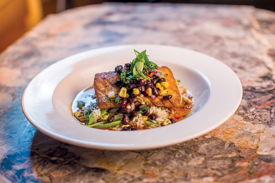 Pan Seared Salmon, with basmati and sugar snap rice, black bean and corn salad, and pineapple chili is among Chef Lou-Anne Langlois' delightful dinner offerings at the Old Lyme Inn. (Seth Jacobson photo)