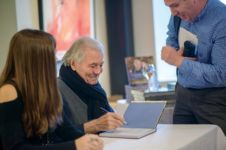 Chef and author Jacques Pepin signs books at La Grua during a recent appearance, as Daniel Varholy looks on. (Peter M. Weber photo)
