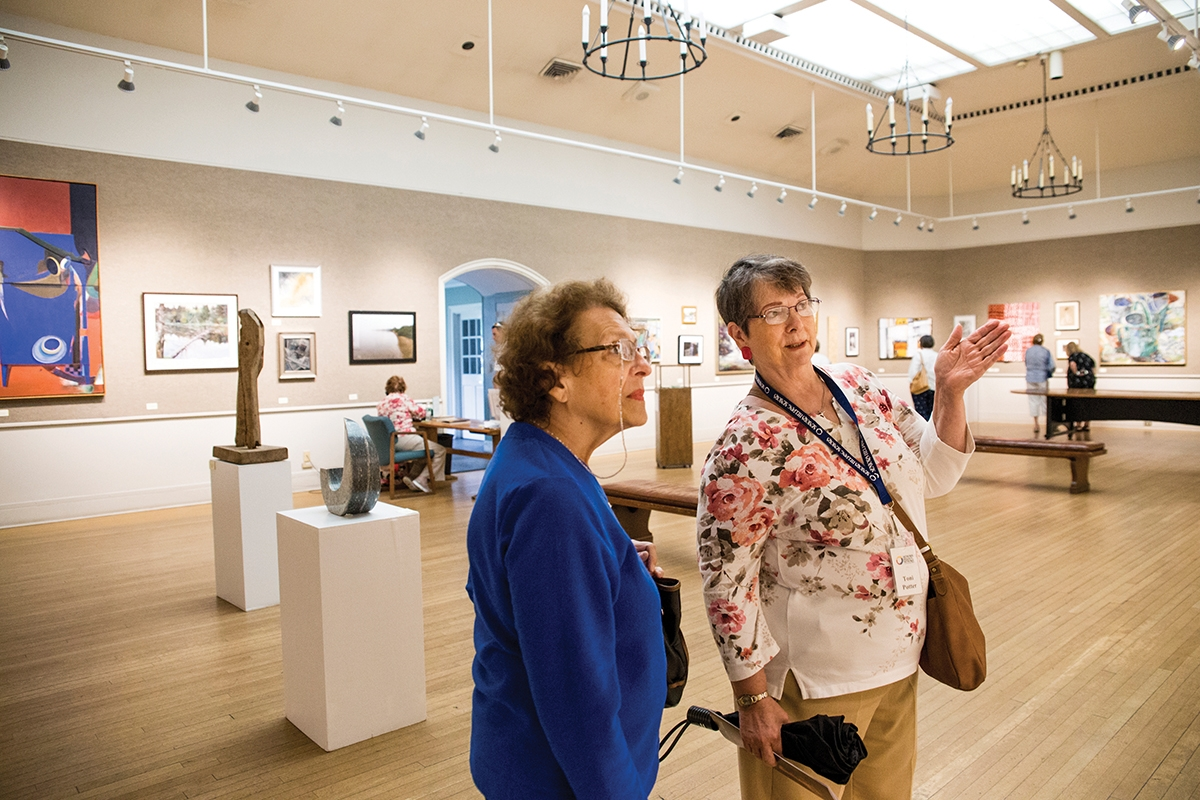 <b></b> Roberta Tuck, left, enjoys time with companion Toni Potter at the Mystic Museum of Art. (Emilie Farrugia photo)