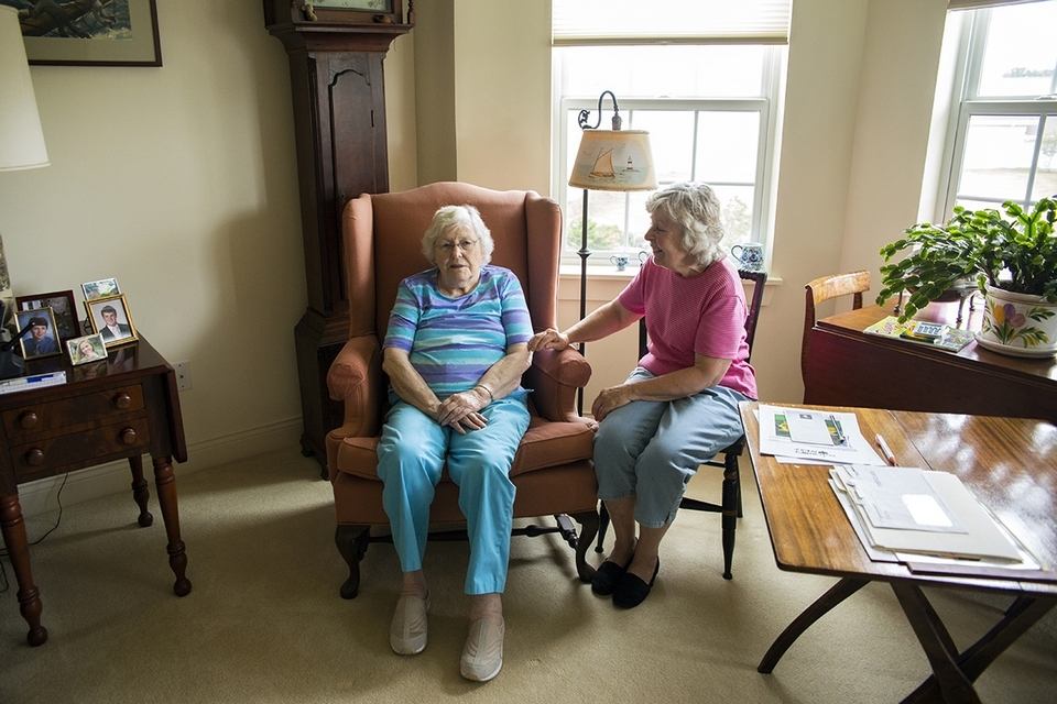 Nancy McKay, left, enjoys a visit with companion Andrea Zaletta. (Emilie Farrugia photo)