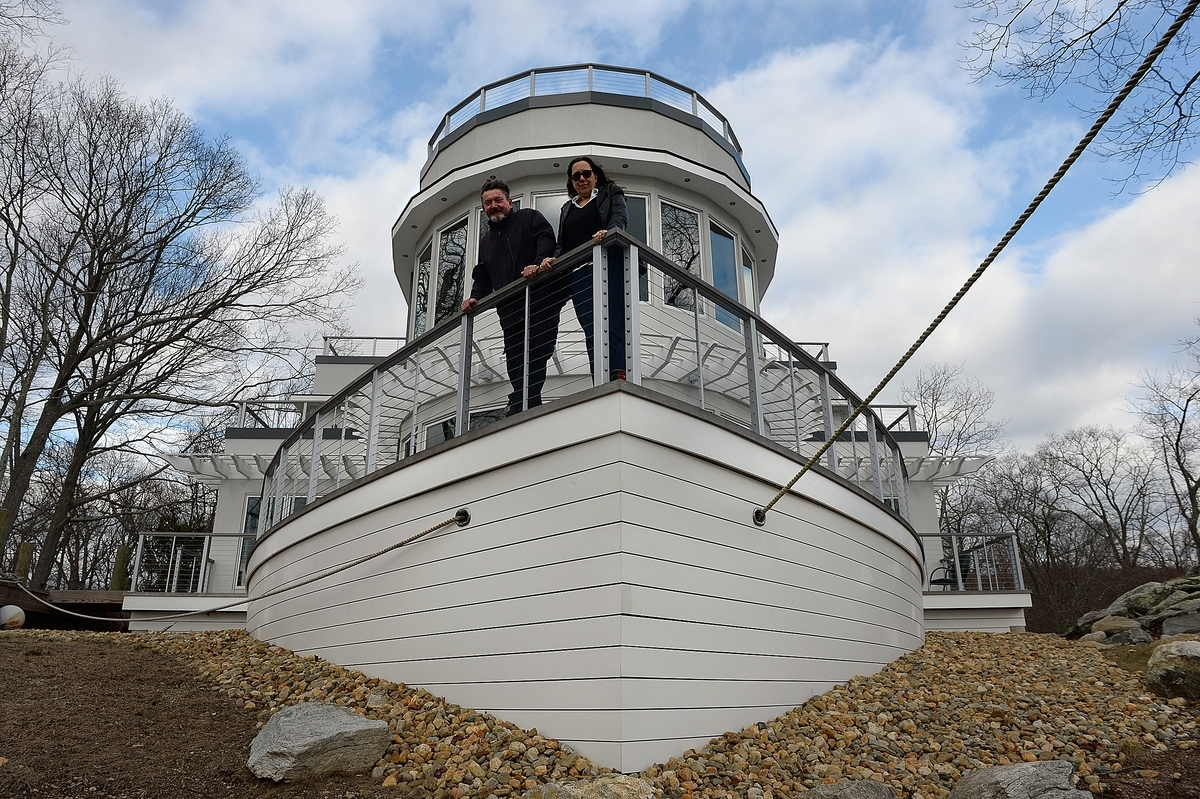 <b></b> Jim and Cathy Barnard on the deck of the bow area of their steamship-styled house overlooking the Niantic River on Saturday, March 10, 2018.  (Dana Jensen/The Day)