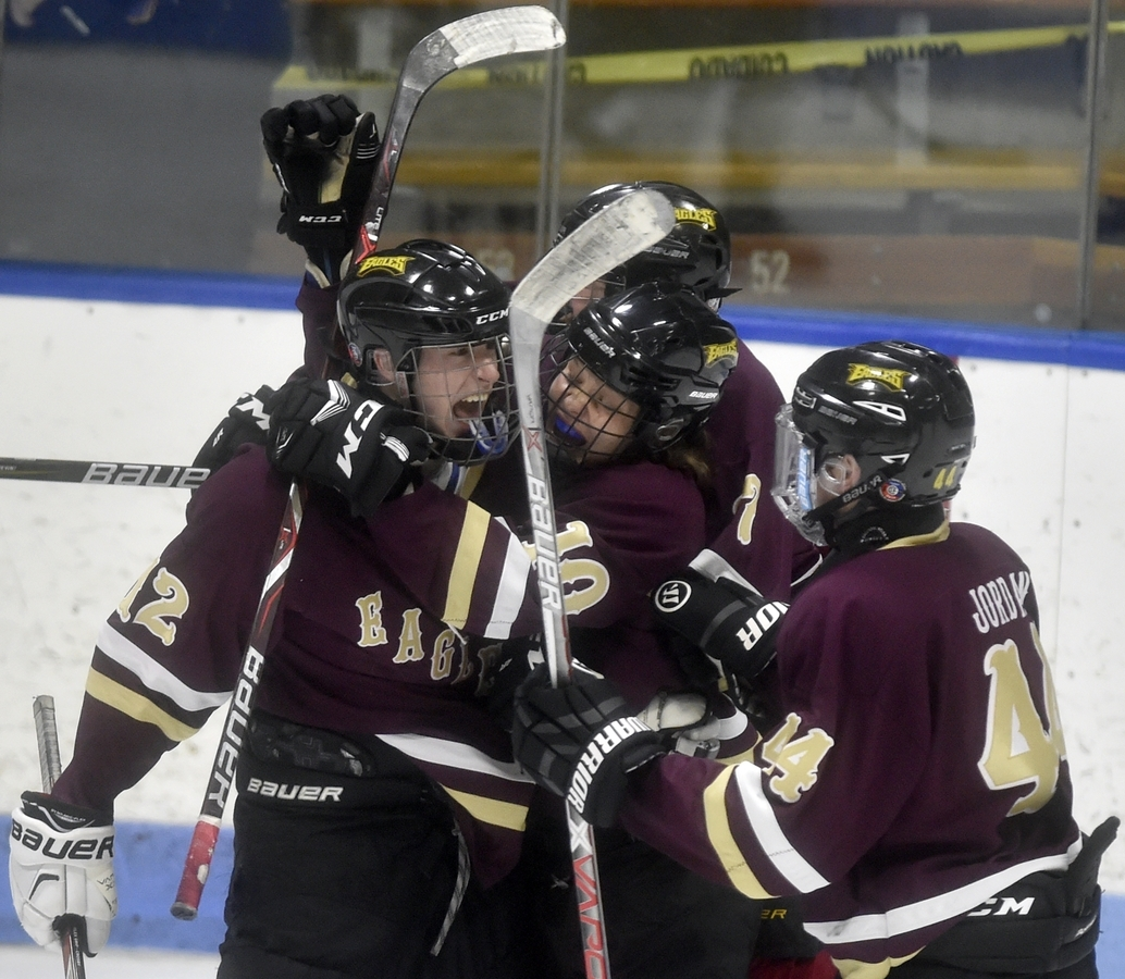 <b></b> Kevin Close, left, of the Eastern Connecticut Eagles reacts to a third-period goal Thursday in the fifth-seeded Eagles&#x2019; 8-6 victory over No. 1 Staples in the CIAC Division III hockey semifinals at Yale University&#x2019;s Ingalls Rink. The Eagles, 4-17 just a year ago, advanced to Saturday&#x2019;s championship game for the first time in the history of the program. (Tim Martin/The Day)