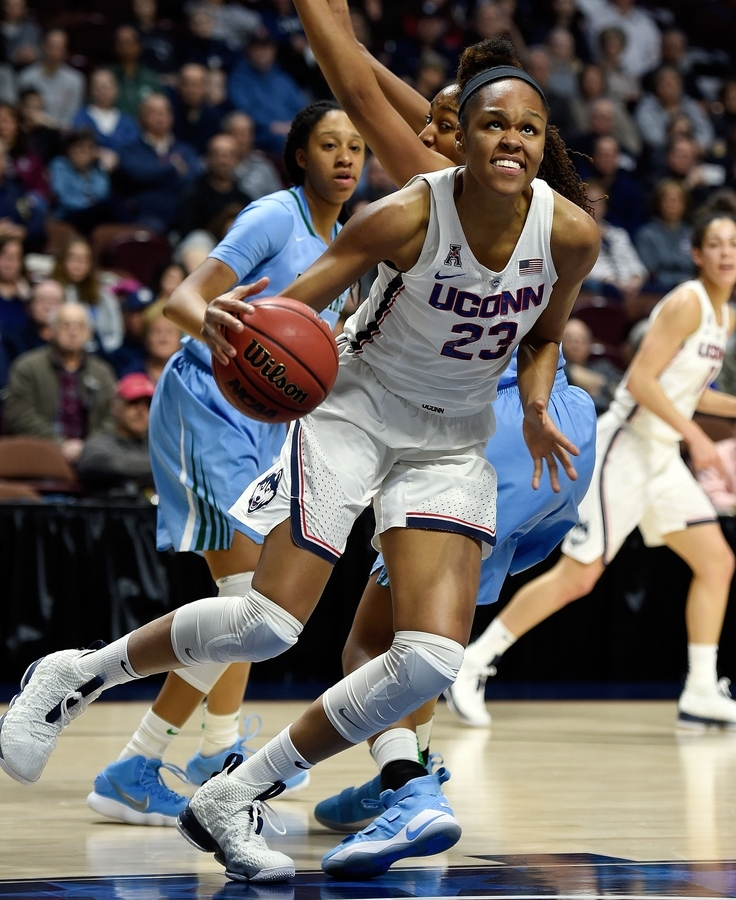 <b></b> UConn's Azura Stevens drives to the basket around her Tulane defender in an American Athletic Conference tournament game on March 4 at Mohegan Sun Arena. (Sean D. Elliot/The Day)