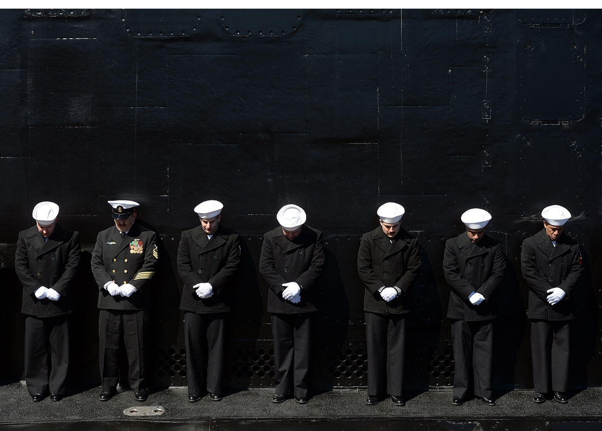 <b></b> The crew of the Virginia-class fast attack submarine USS Colorado (SSN 788) bow their heads for the benediction while manning the rails during the commissioning ceremony at the Naval Submarine Base New London in Groton, Conn., on Saturday, March 17, 2018.  (Dana Jensen/The Day)
