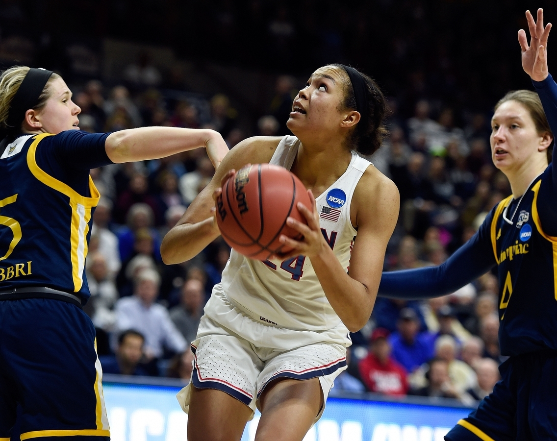 <b></b> UConn's Napheesa Collier splits the defense of Quinnipiac's Carly Fabbri, left, and Paula Strautmaine in the second half of the second round NCAA tournament game on Monday at Gampel Pavilion in Storrs. (Sean D. Elliot/The Day)