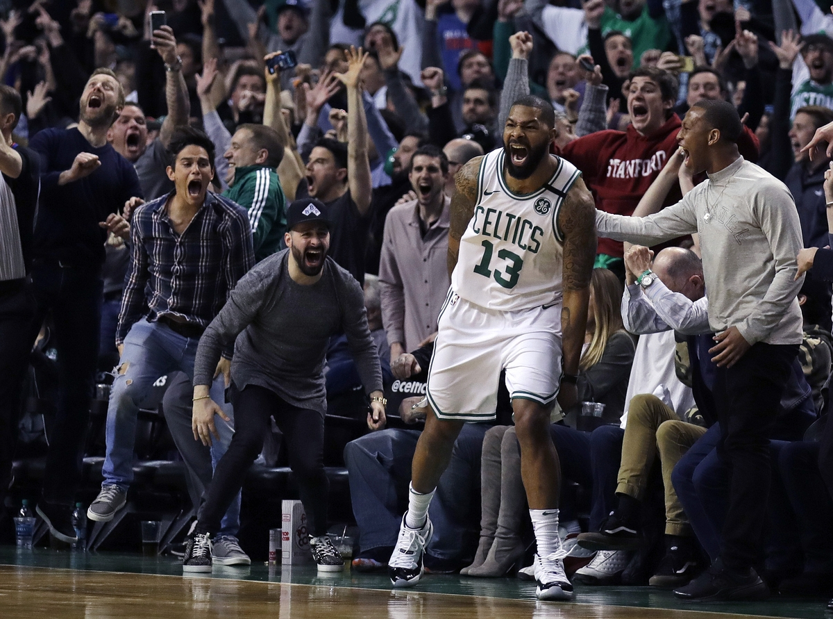 <b></b> Celtics forward Marcus Morris (13) and fans celebrate his game-winning 3-point shot in Tuesday's game against the Thunder at Boston. The Celtics won 100-99. (AP Photo/Charles Krupa)