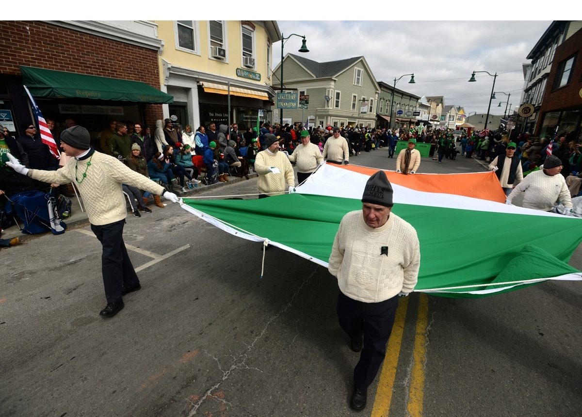 <b></b> Members of the Rev. John F. Murphy Knights of Columbus of Mystic carry the national flag of Ireland through downtown while participating in the 14th annual Mystic Irish Parade last year. (Dana Jensen/The Day)