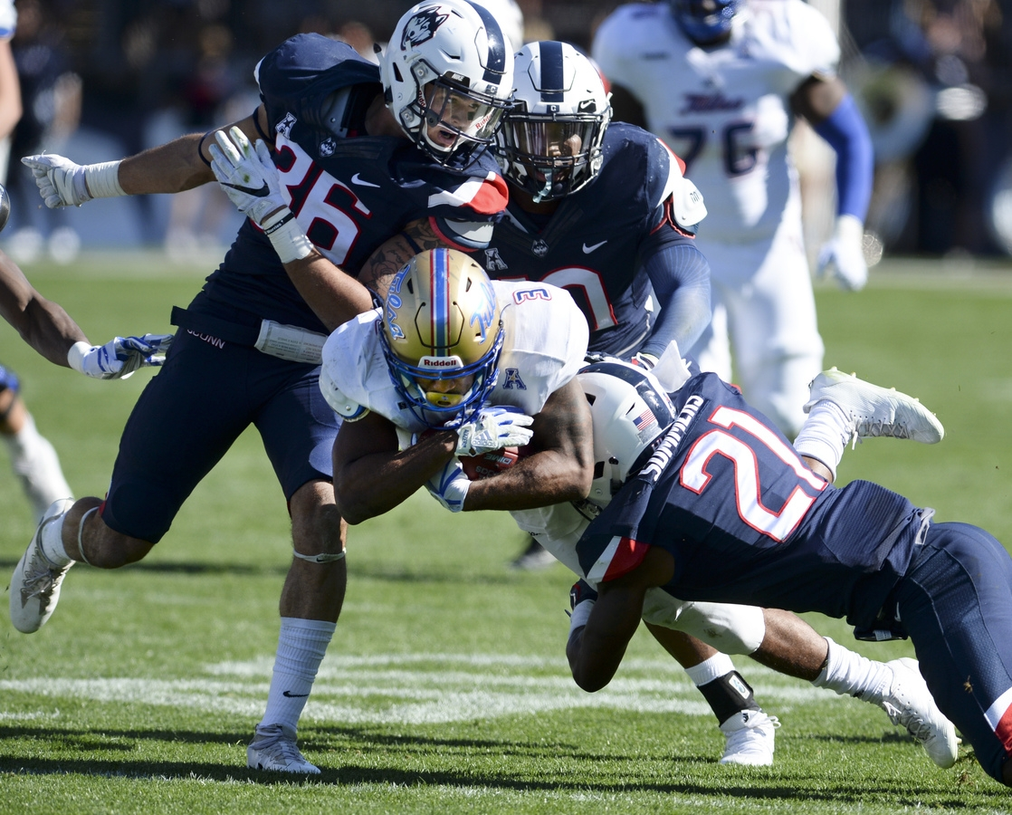 <b></b> UConn defensive back Jamar Summers, right, tackles Tulsa running back Shamari Brooks (3) on Oct. 21, 2017 in a game at Rentschler Field in East Hartford. (AP Photo/Stephen Dunn)