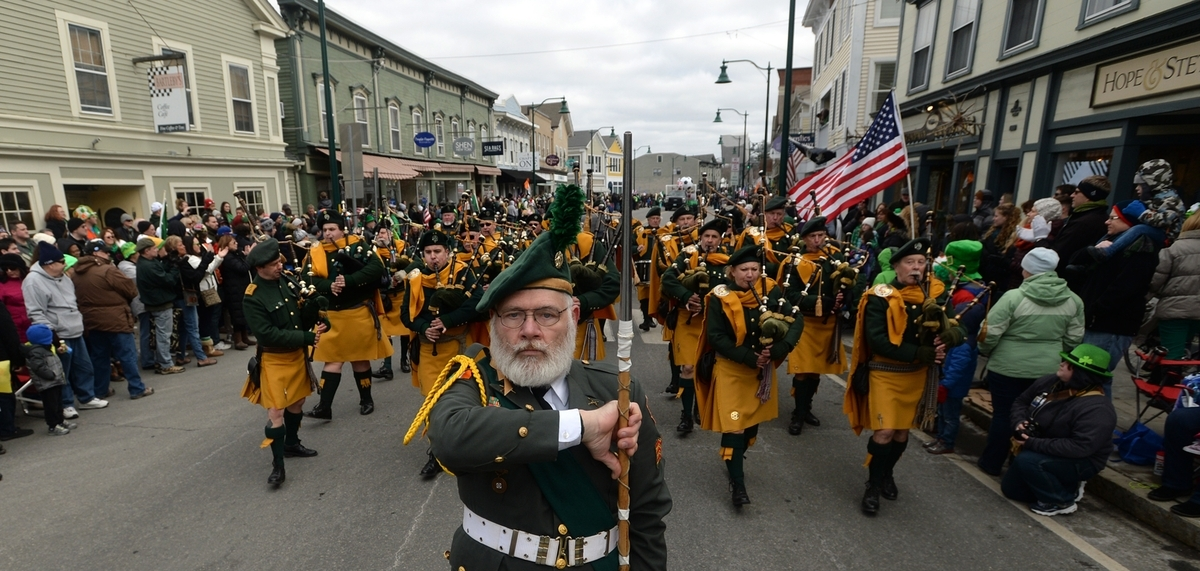 <b></b> The drum major for the Ancient Order of Hibernian's Pipes and Drums of Newport, R.I., leads the band through downtown Mystic during the 14th annual Mystic Irish Parade on March 19, 2017.  This year's parade will be held Sunday, March 25, 2018. (Dana Jensen/The Day)