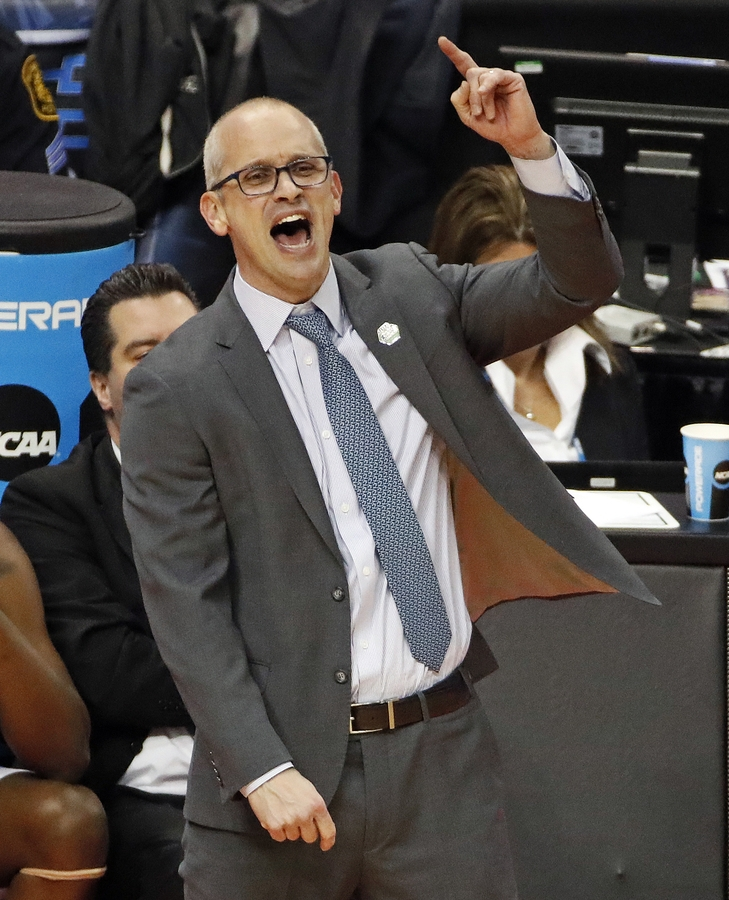 <b></b> Rhode Island head coach Dan Hurley disagrees with a foul called during the first half of an NCAA men's college basketball tournament second-round game against Duke, in Pittsburgh, Saturday, March 17, 2018. Duke won 87-62. (AP Photo/Gene J. Puskar)