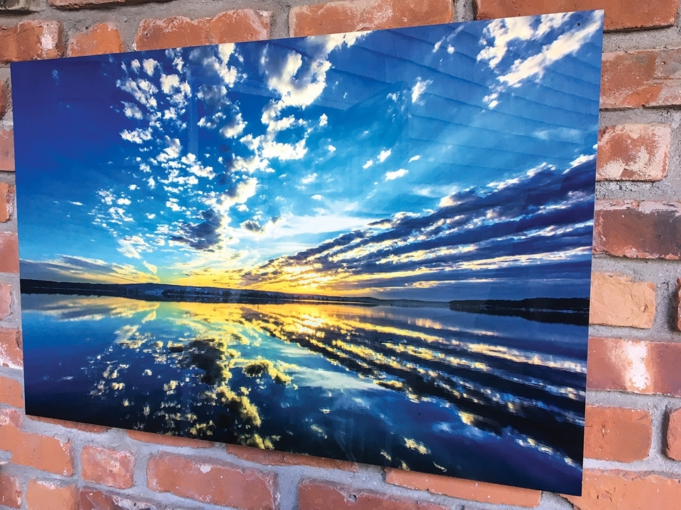 This sunset image by local photographer Steven Adler has happily survived outdoor display all winter in the private courtyard at the Gallery at Firehouse Square in downtown New London. Aluminum prints are weather-resistant, which makes them ideal for bringing art to outdoor living and gathering spaces. (Submitted photo)