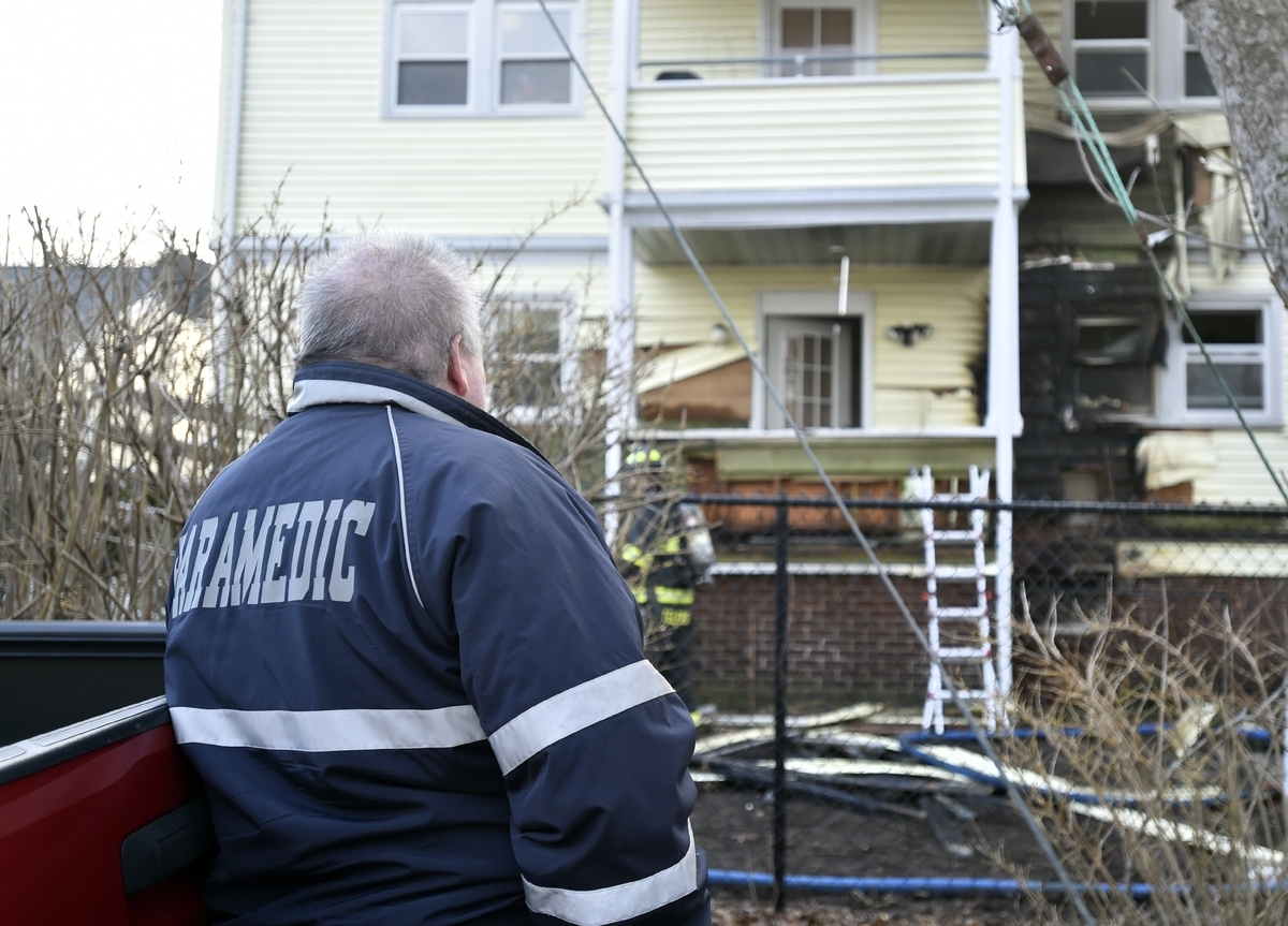 <b></b> Lawrence + Memorial paramedic Bill Daley at the scene of a structure fire at 12 Sharaf Street in New London, Thursday, March 22, 2018.  (Tim Martin/The Day)