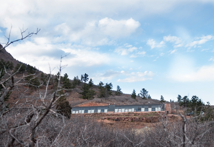 Mount Herman rises in the background of this Earthship home in Denver, Colo.