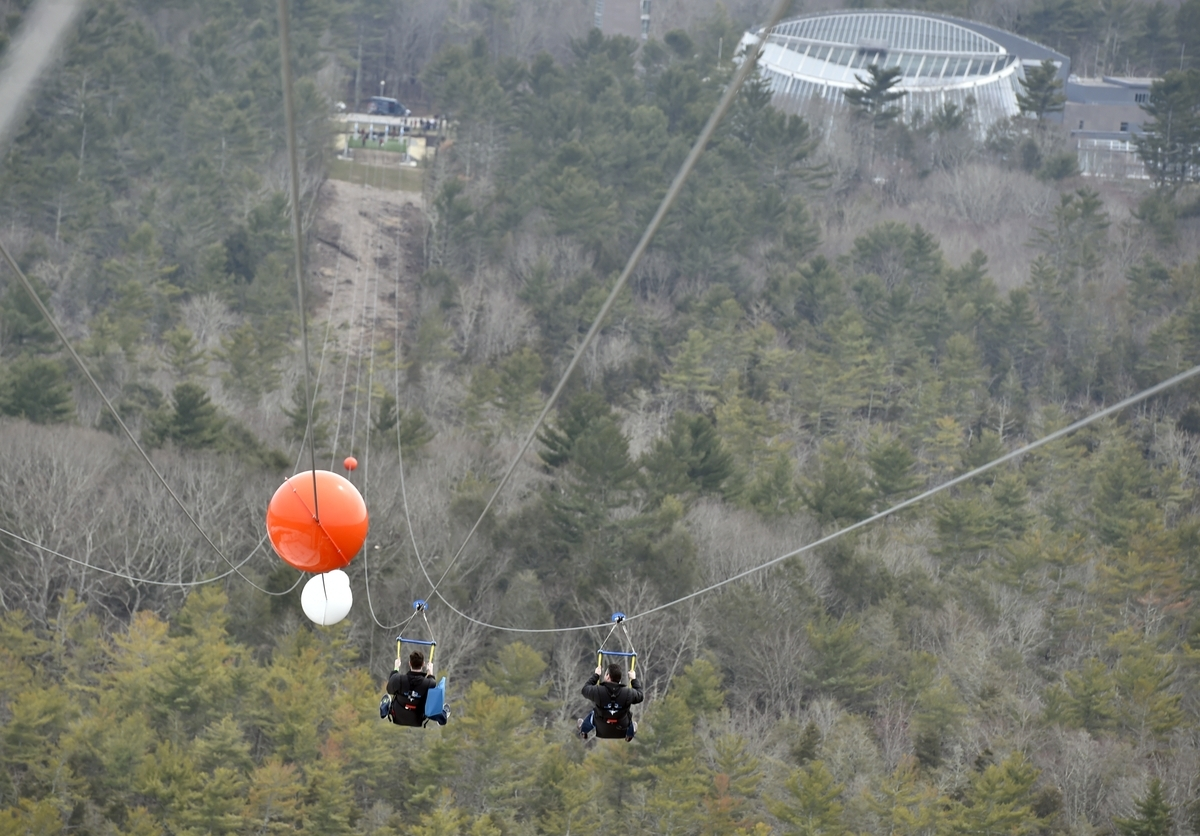 <b></b> People ride the HighFlyer Zipline at Foxwoods Resort Casino on Thursday, April 12, 2018, when there was a ribbon cutting ceremony and media tour. The zipline starts 350 feet off the ground on top of Fox Tower and ends a mile away, at the Mashantucket Pequot Museum & Research Center.  (Tim Martin/The Day)