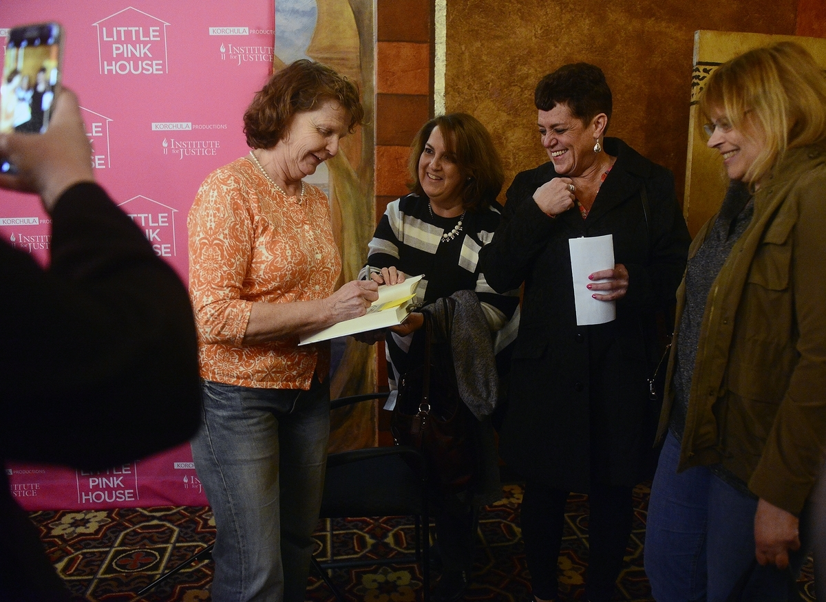 <b></b> Susette Kelo signs a copy of