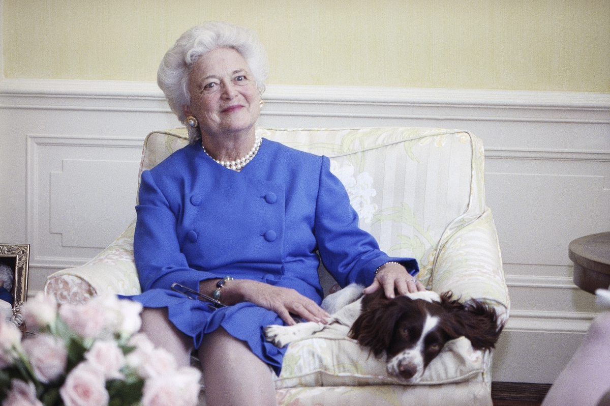 <b></b> In this 1990 file photo, first lady Barbara Bush poses with her dog Millie in Washington. A family spokesman said Tuesday, April 17, 2018, that former first lady Barbara Bush has died at the age of 92. (AP Photo/Doug Mills, File)