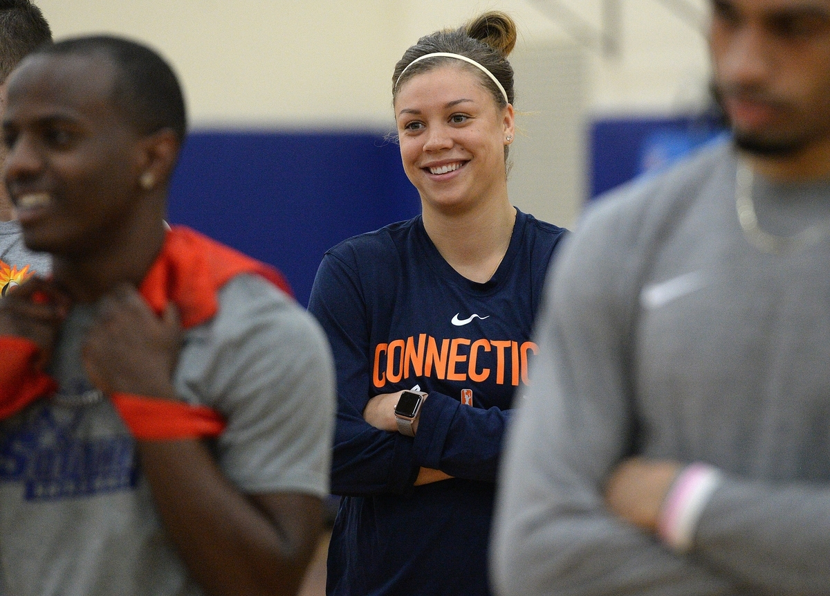 <b></b> Connecticut Sun guard Rachel Banham smiles while head coach Curt Miller talks about how the players and practice squad members support each other after Saturday's practice at the Mohegan Sun Community Center in Uncasville. (Dana Jensen/The Day)