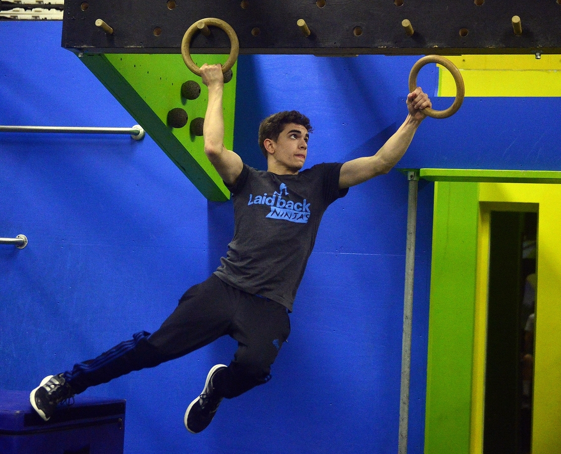 <b></b> Emmett Breen, of Stonington, works through a course at Laid-back Fitness in Warwick, Rhode Island. He trains for and participates in teenage ninja warrior competitions across the country. (Sarah Gordon/The Day)