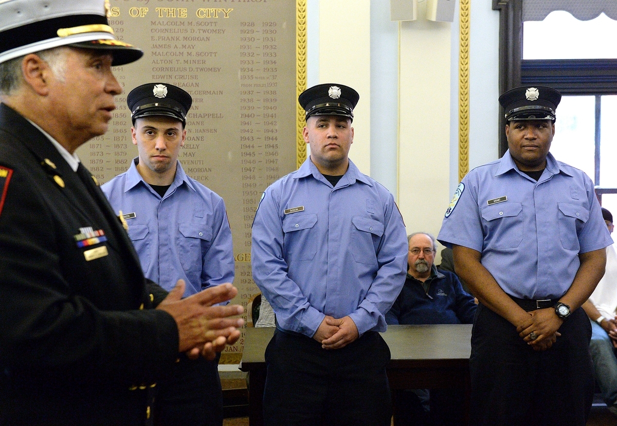 From left, Chief Henry Kydd speaks as Nicholas Petrizzi III, Brian DeSilva and Markeno Grant listen during their New London Fire Department swearing-in ceremony at City Hall on Wednesday, May 16, 2018. The hiring of the three new fire department members was made possible by a Federal Emergency Management Agency Staffing for Adequate Fire and Emergency Response grant.  (Dana Jensen/The Day)