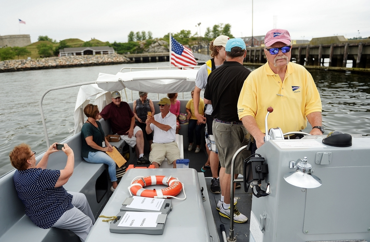 <b></b> Charlie Allen, right, captains the Thames River Water Taxi M/V Groton as it departs Fort Trumbull State Park for its inaugural trip across the Thames River on July 1, 2016. When it opens for the season this year, it will run later than in previous years to accommodate passengers who want to use it to get home from dinner or evening events. (Sean D. Elliot/The Day)