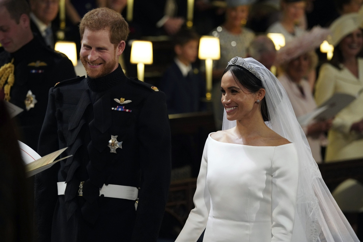 <b></b> Britain's Prince Harry and Meghan Markle smile during their wedding ceremony in St. George's Chapel in Windsor Castle in Windsor, near London, England, Saturday, May 19, 2018. (Jonathan Brady/pool photo via AP)