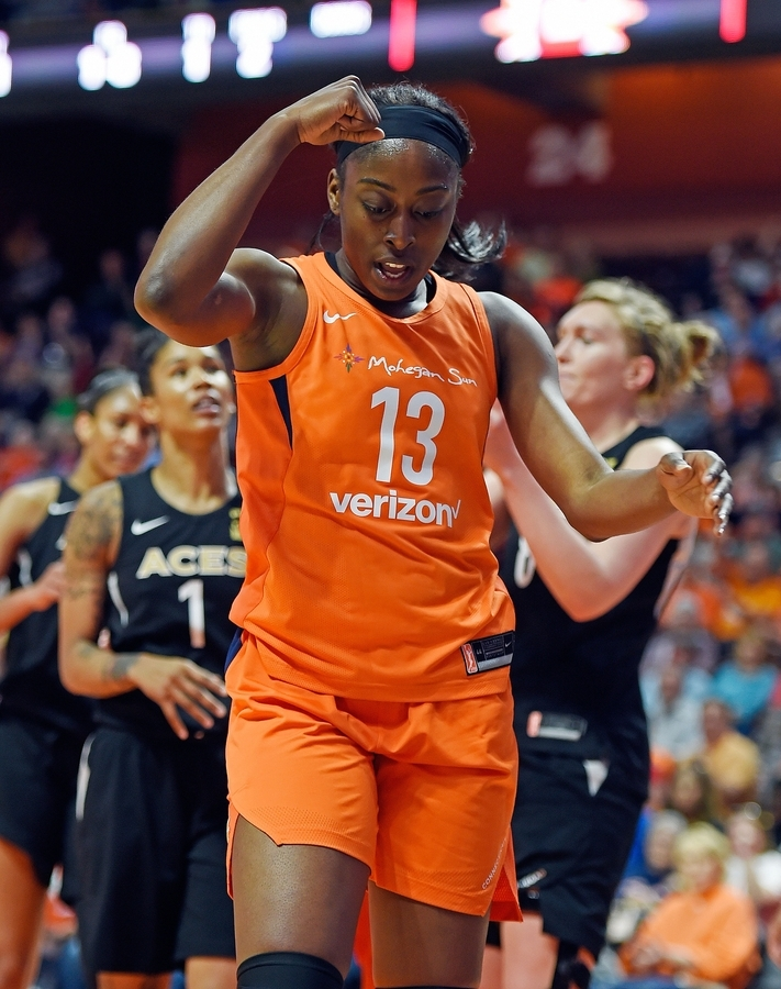 <b></b> Connecticut Sun forward Chiney Ogwumike celebrates the basket after being fouled by Las Vegas Aces forward Tamera Young (1) in the first half of Sunday's WNBA game at Mohegan Sun Arena. The Sun won 101-65.  (Sean D. Elliot/The Day)