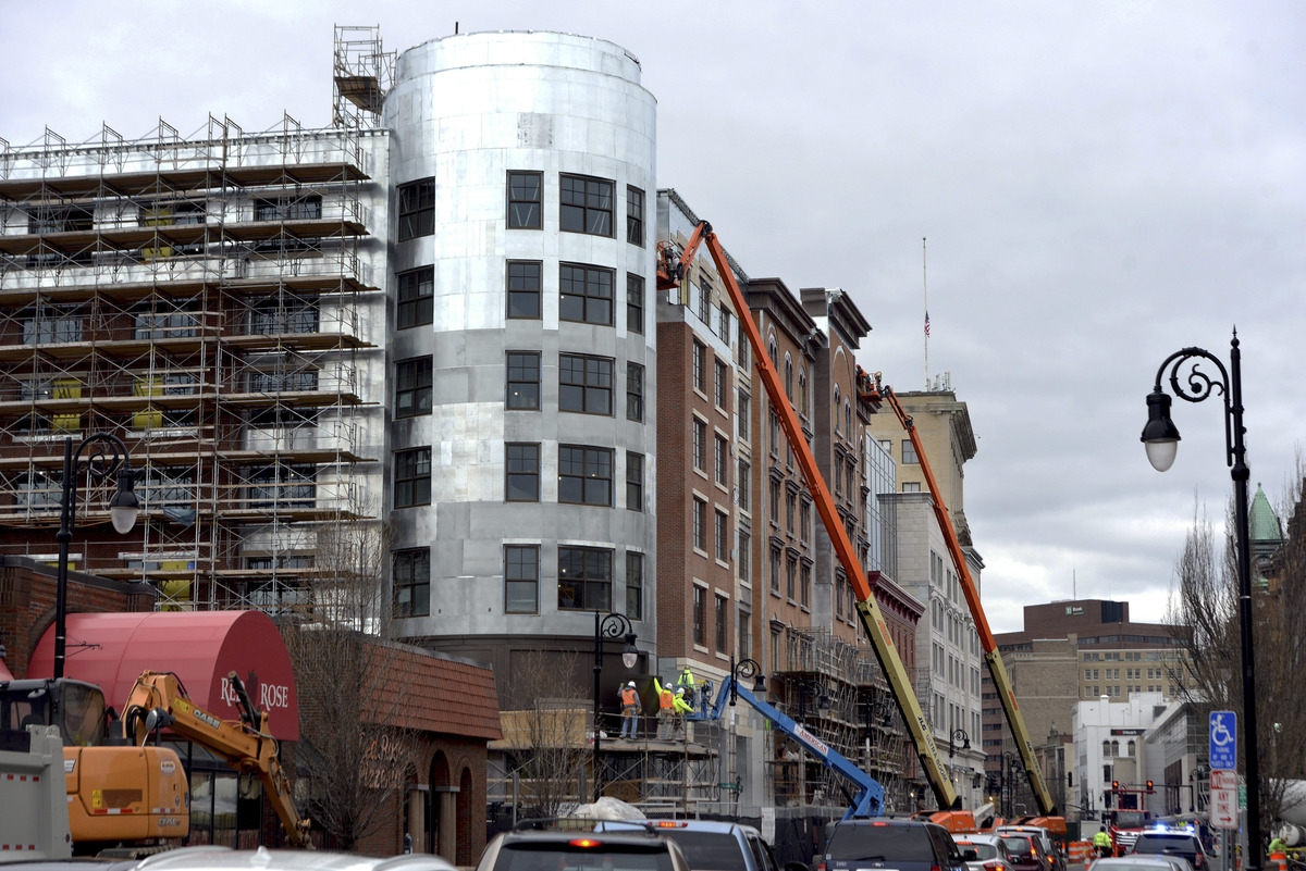 <b></b> Construction progresses April 18, 2018, on the MGM Casino in downtown Springfield, Mass., which is on track to open Aug. 24. The casino is requesting to serve alcohol until 4 a.m. on the gaming floor, a move that could make the facility even more competitive with Connecticut's tribal casinos, which can serve such beverages only  until 1 a.m. weekdays and 2 a.m. Fridays and Saturdays. (Don Treeger/The Republican via AP)