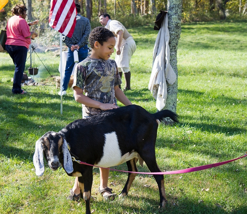 Families enjoy a farm animal demonstration during a recent event at the Samuel Smith Farmstead. (Renee Trafford photo)