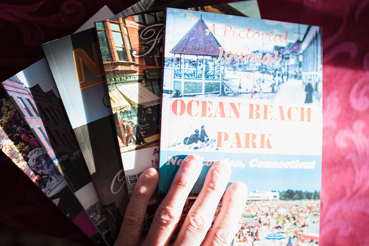 "Norwich resident Ken Keeley has compiled five pictorial books about local history: ""Four Score & 10"", ""Memories of a Norwich Boomer"", ""Norwich: It's Where Our Story Begins"", ""The History of the Rose Arts Festival"", and ""A Pictorial Journal of Ocean Beach Park"" (Photo by Margit Fish)"
