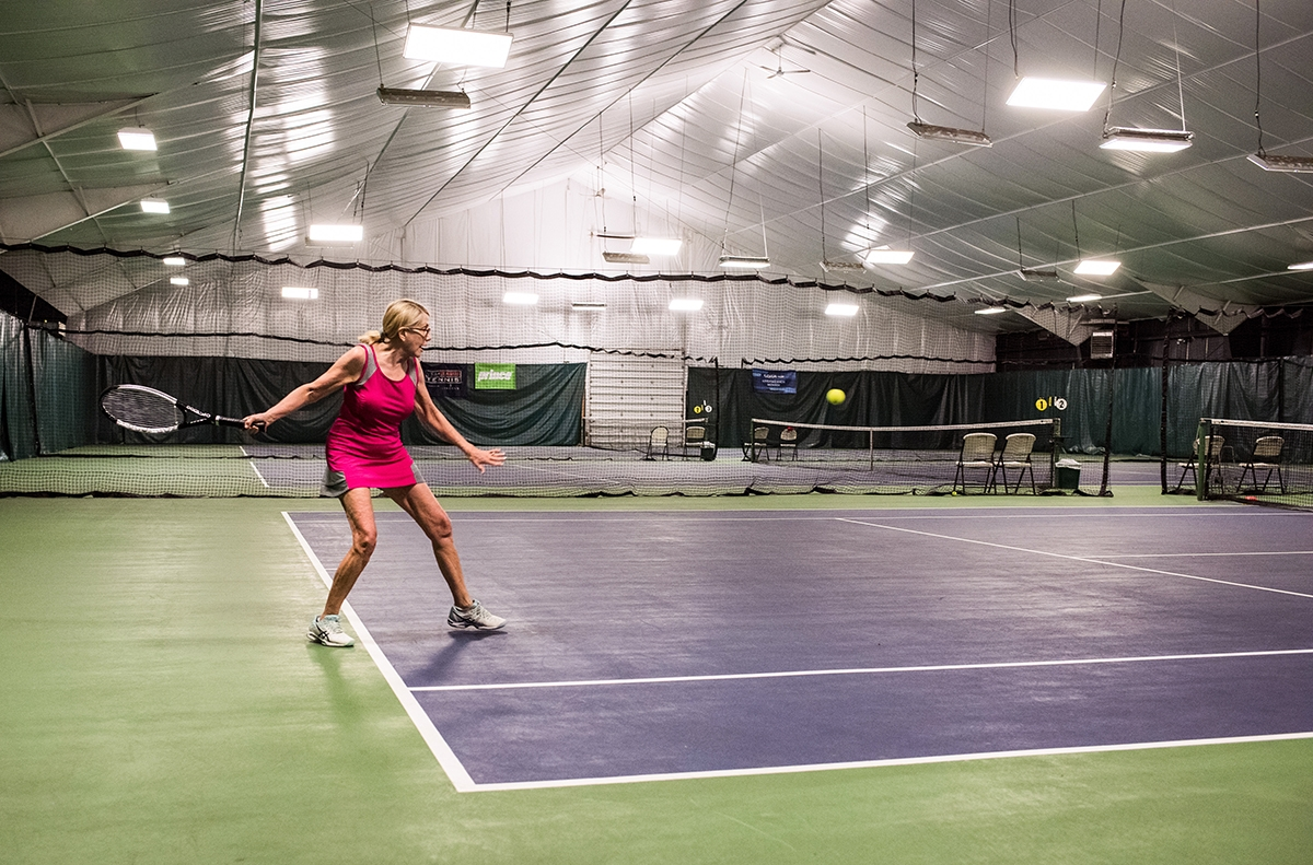 Jane Pfeffer plays tennis at Lyme Shores Tennis & Conditioning Center. (Photo by Peter M. Weber)