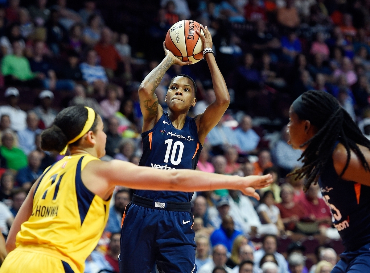 <b></b> Connecticut Sun guard Courtney Williams shoots over Indiana Fever defender Natalie Achonwa in the first half of WNBA Eastern Conference action June 27 at Mohegan Sun Arena. Williams missed a four-game road trip last week with the Sun, but will return for this morning's game against New York. (Sean D. Elliot/The Day)