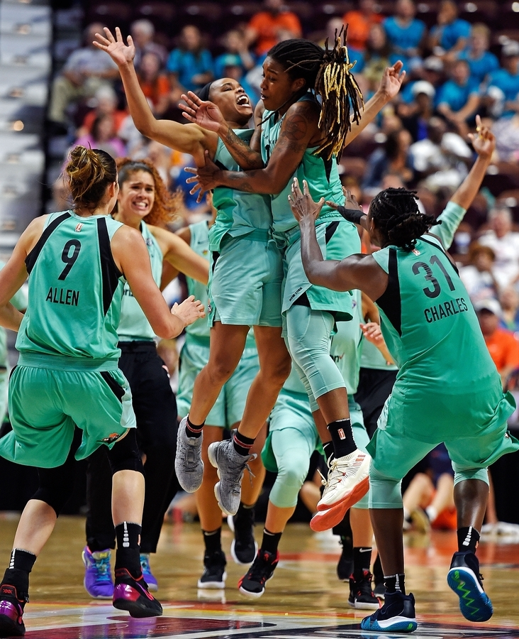 <b></b> New York Liberty guard Shavonte Zellous, leaping, right, celebrates with her teammates after hitting a 3-pointer at the buzzer to defeat the Connecticut Sun in WNBA Eastern Conference action Wednesday at Mohegan Sun Arena. The Liberty emerged with the 79-76 win. (Sean D. Elliot/The Day)