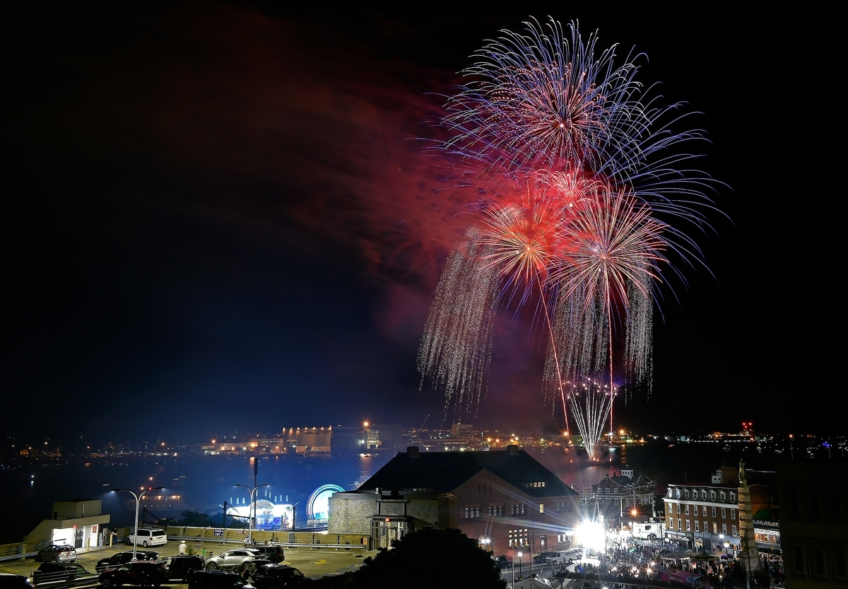 <b></b> Fireworks illuminate the sky over New London Harbor, during Sailfest in New London on Saturday, July 14, 2018. (Tim Martin/The Day)