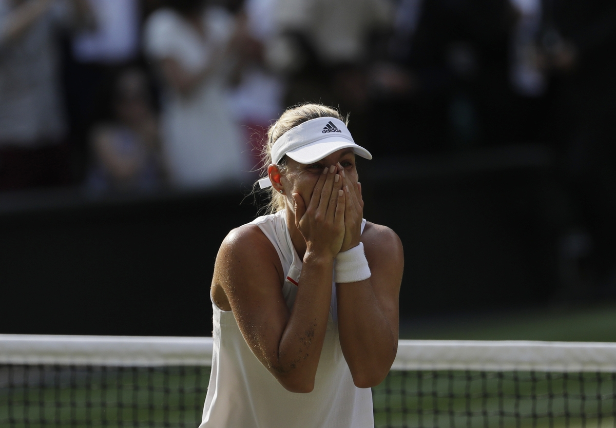 <b></b> Angelique Kerber celebrates defeating Serena Williams in their women's singles final match at the Wimbledon Tennis Championships in London on Saturday. (Ben Curtis/AP Photo)