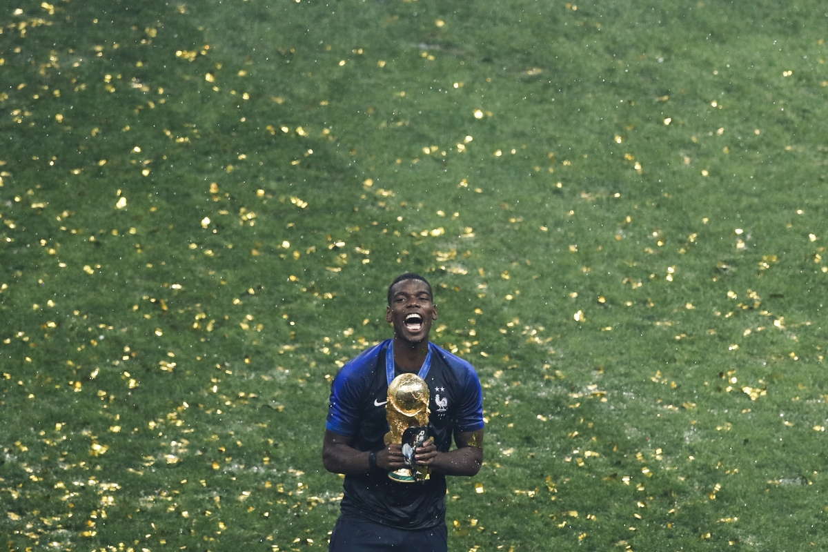 <b></b> France's Paul Pogba celebrates with the trophy at the end of the World Cup final Sunday at Luzhniki Stadium in Moscow. France won the championship 4-2. (Rebecca Blackwell/AP Photo)